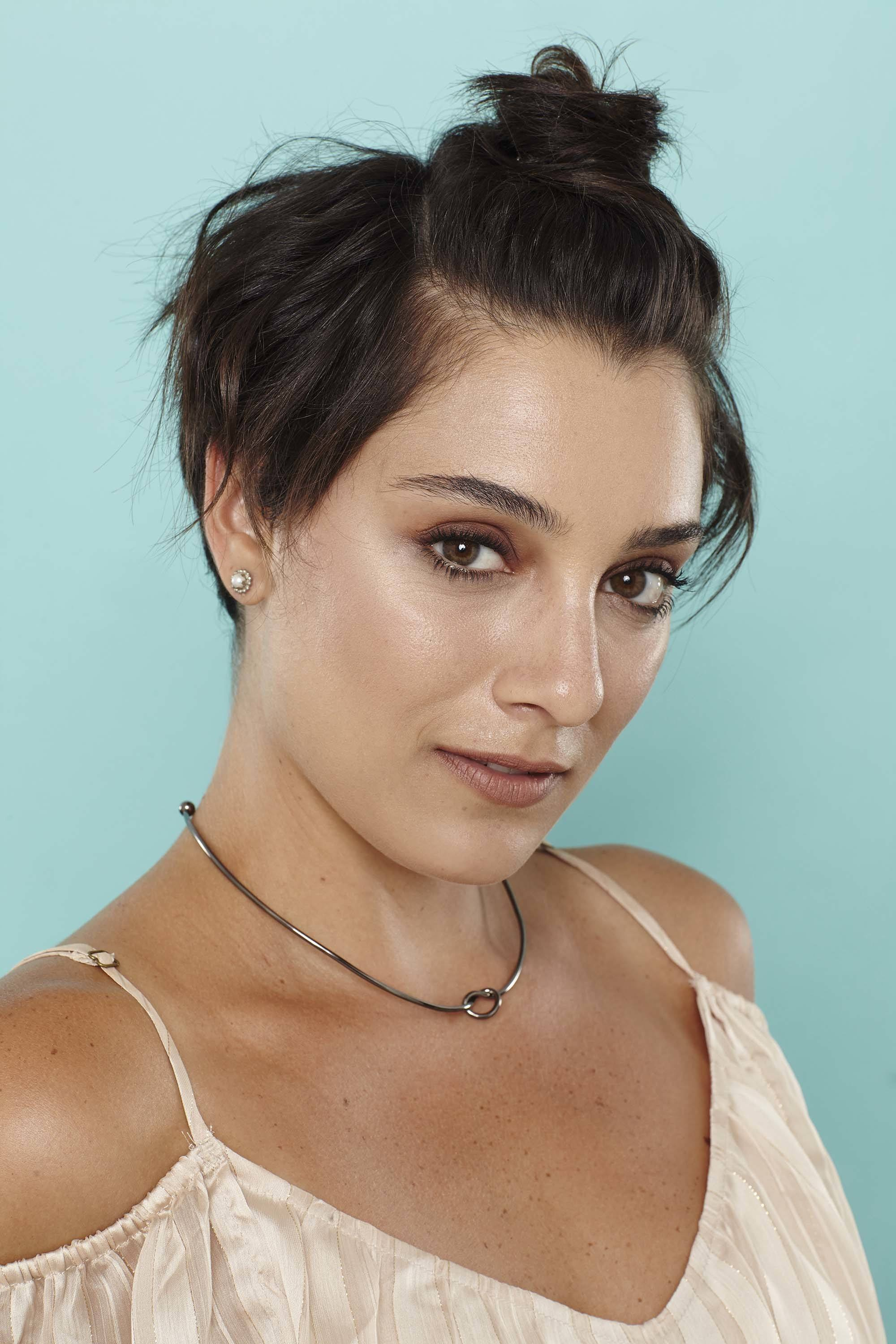 Short summer hairstyles - dark brown pixie crop with top bun