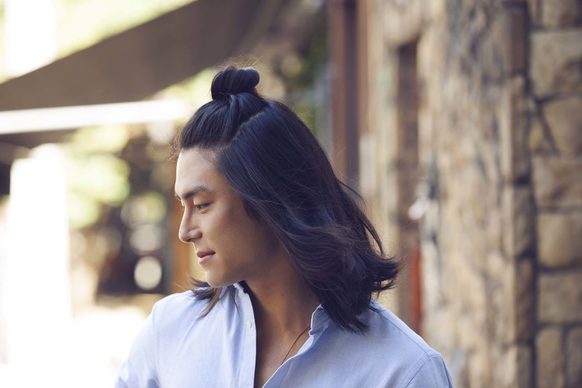 Top Knot Men: Male Model With Half Up Man Bun Hairstyle With Blue Shirt