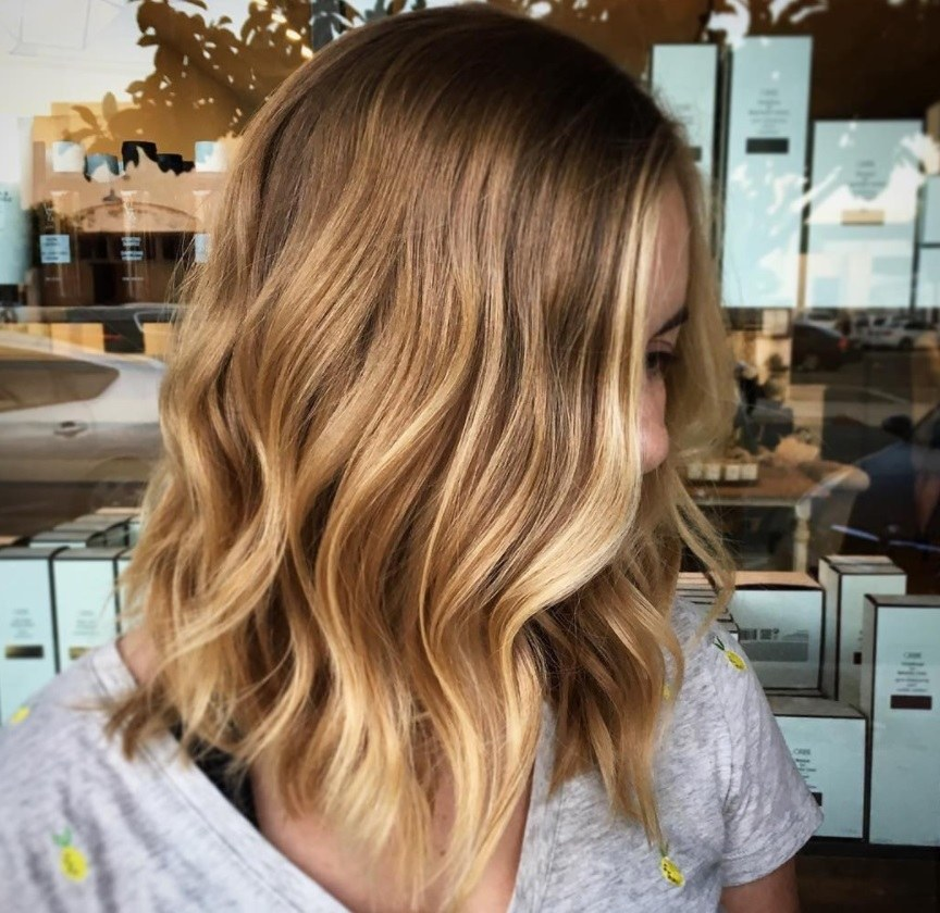 woman with honey blonde balayage hair colour at the salon