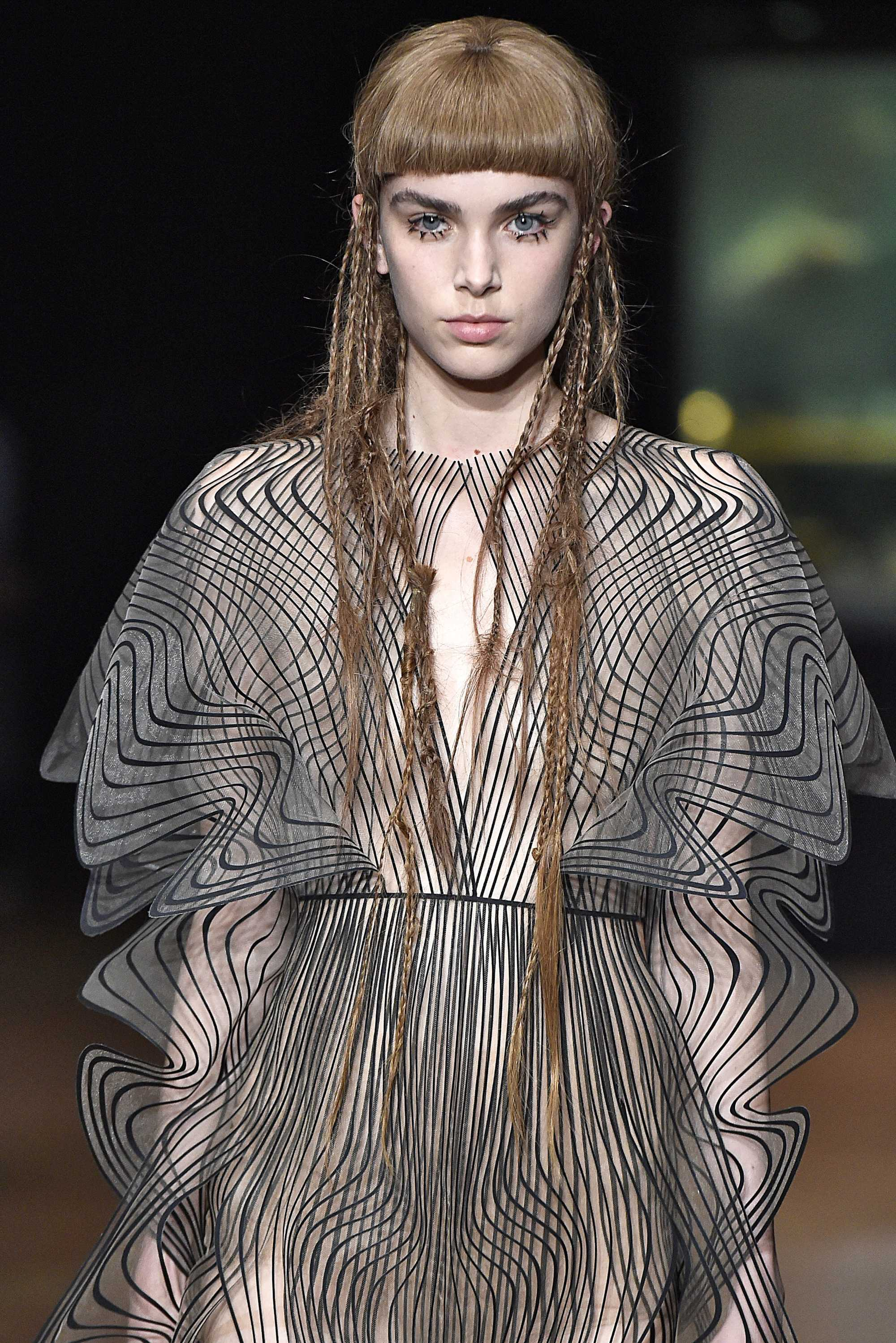 model with hidden plaits and micro bangs on the iris van herpen runway paris haute couture week