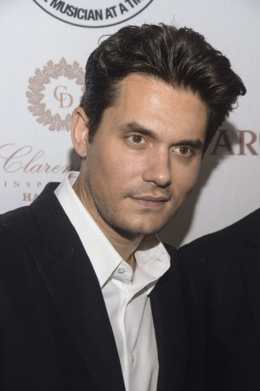 American singer John Mayer on the red carpet with his trademark brunette quiffed hair