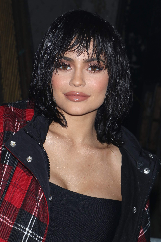 Kylie Jenner with black wet look shag hair