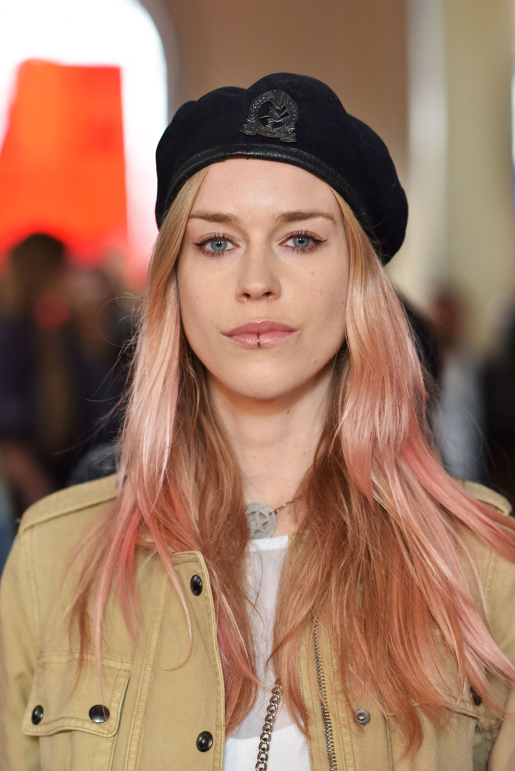 lady mary charteris with wavy pastel hair with a belstaff beret
