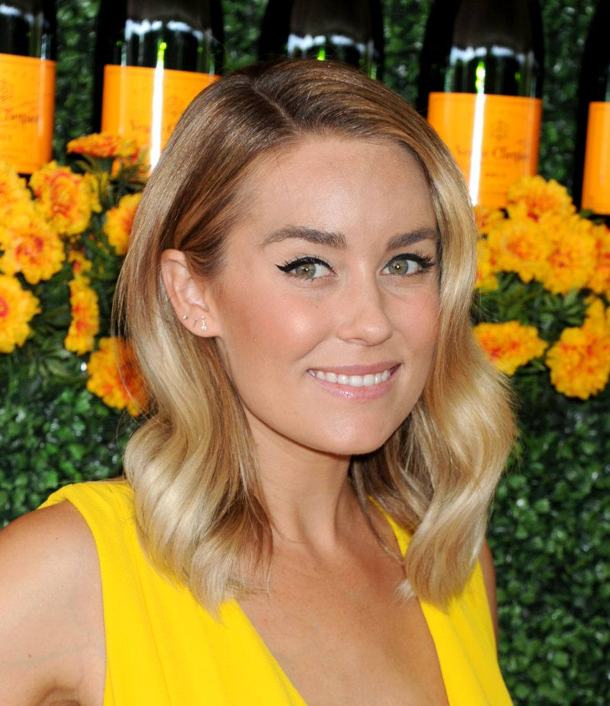 Lauren Conrad with a blonde long bob with side parting and loose hollywood waves