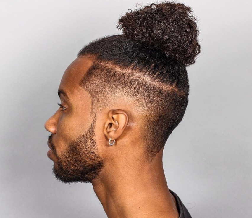 Wonderful Black Men With Textured Male Top Knot Hairstyle With Disconnected Fade