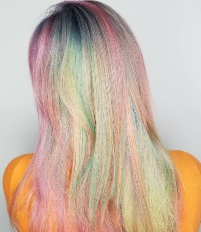back shot of woman with lucky charm cereal inspired hair colour
