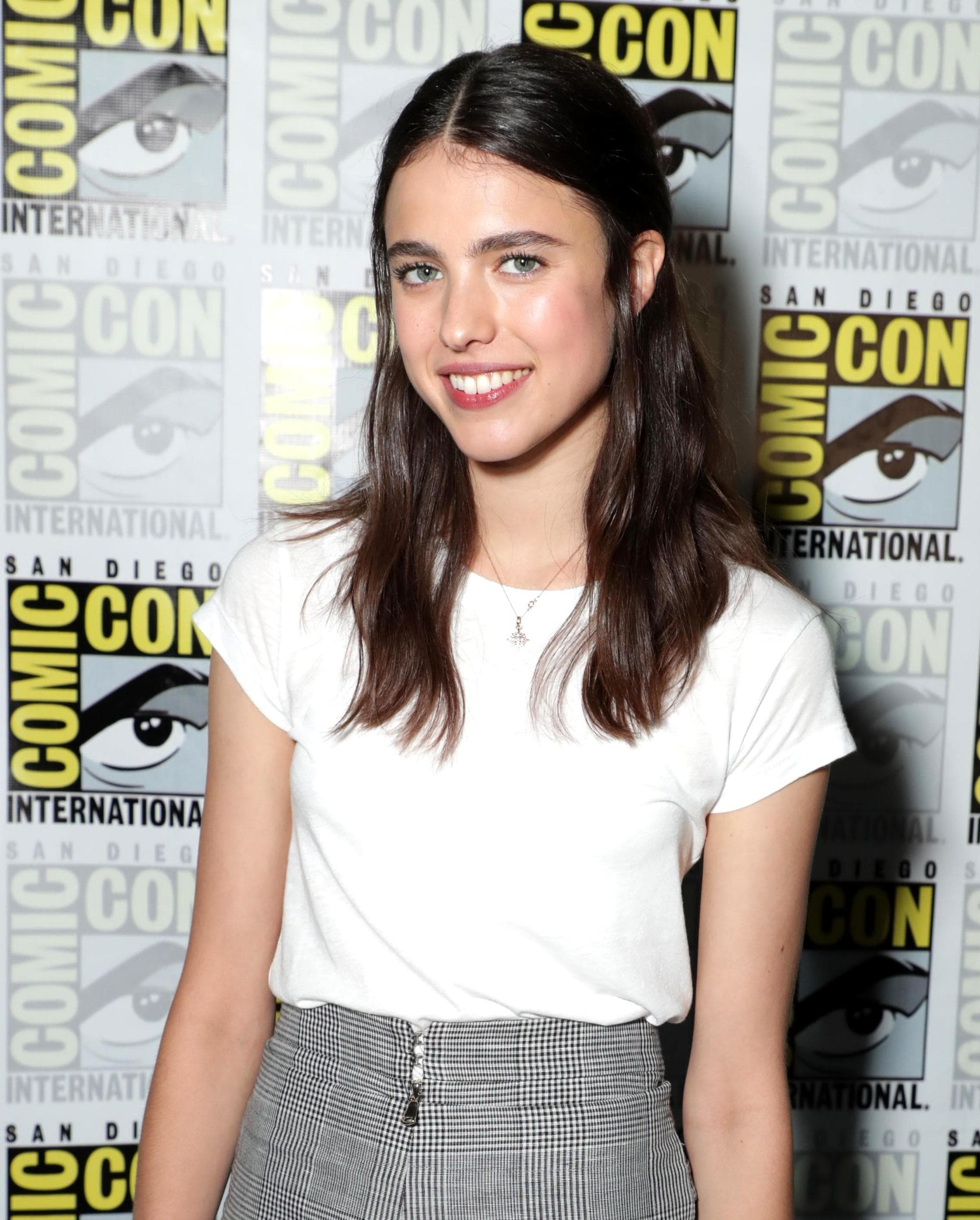 andy mcdowalls daughter actress margaret qualley at san diego comic con with her brunette hair in a half up half down style