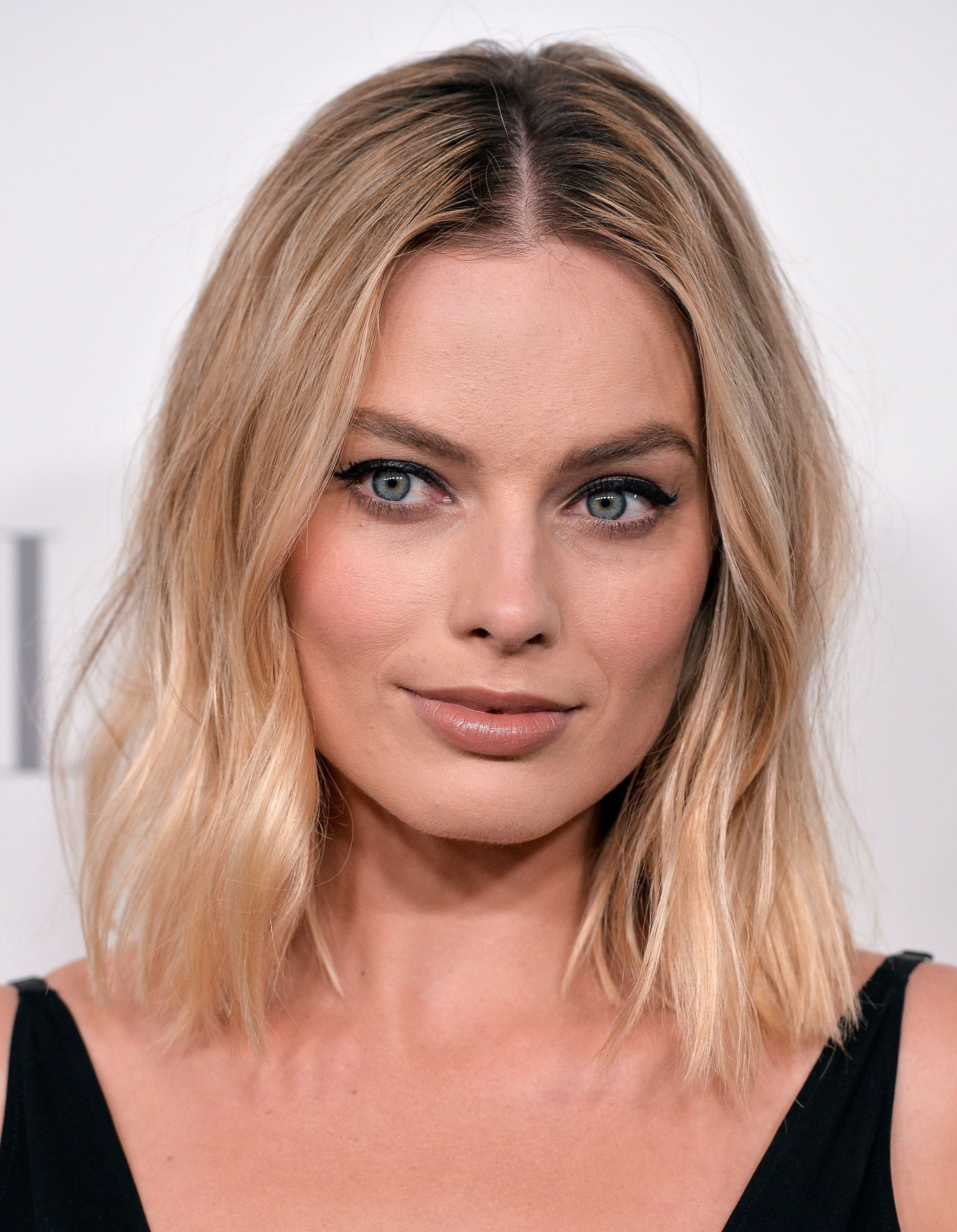 Shoulder length layered hair: Margot Robbie with an ash blonde wavy long bob with layers