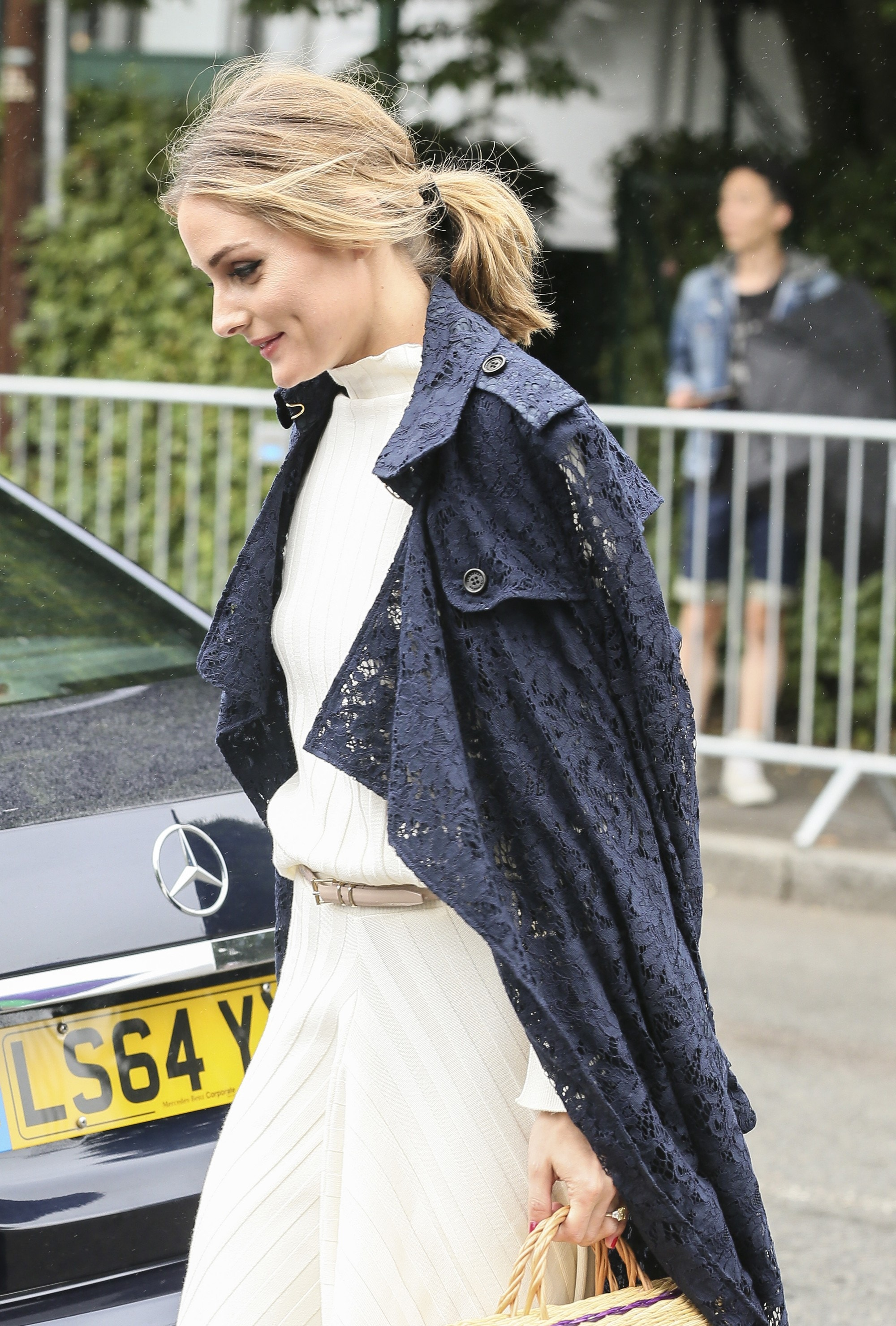 american fashionista olivia palermo with her dark blonde hair in a ponytail tied with a black ribbon