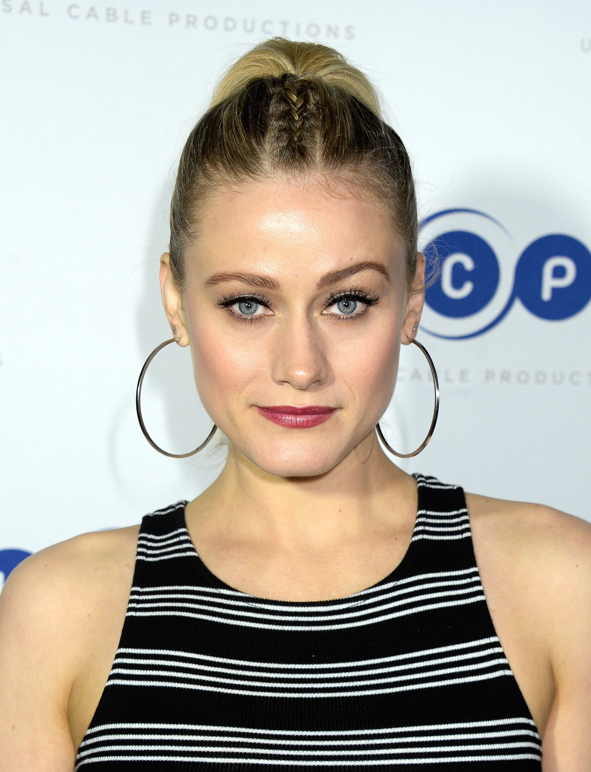 the magicians actress olivia taylor dudley with her blonde hair in a parting plait