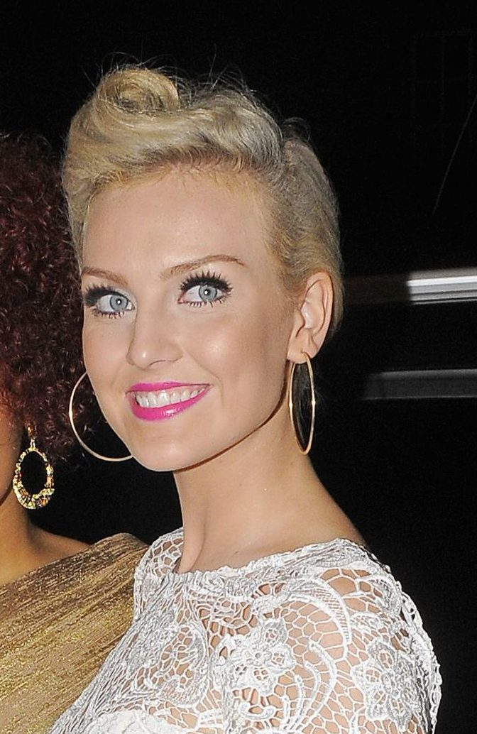 little mix star perrie edwards with her blonde hair in a victory roll hairstyle
