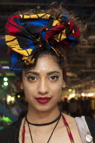 front shot of model with pineapple scarf updo at afropunk