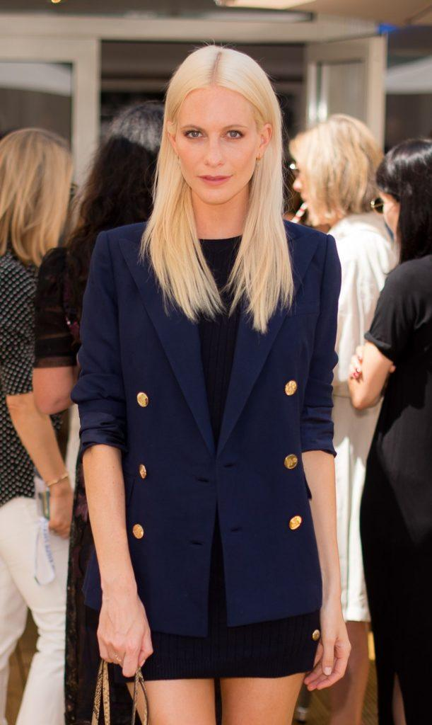 british model poppy delevingne with her ice blonde hair straightened and sleek
