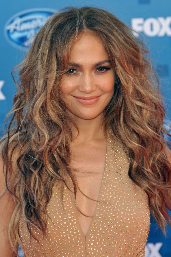 Jennifer Lopez in 2011 with big voluminous wavy hair in light brown with blond ehighlights