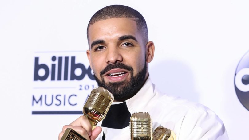 Drake at the 2017 Billboard Music Awards with one slight fade buzzcut and shaved slit on one side of hair