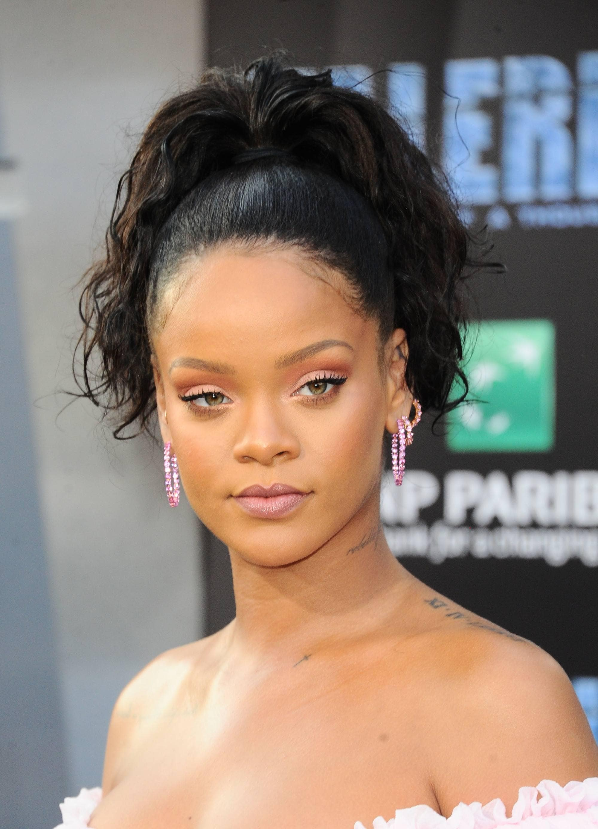 Rihanna with high ponytail with curls in it, at the Valerian premiere