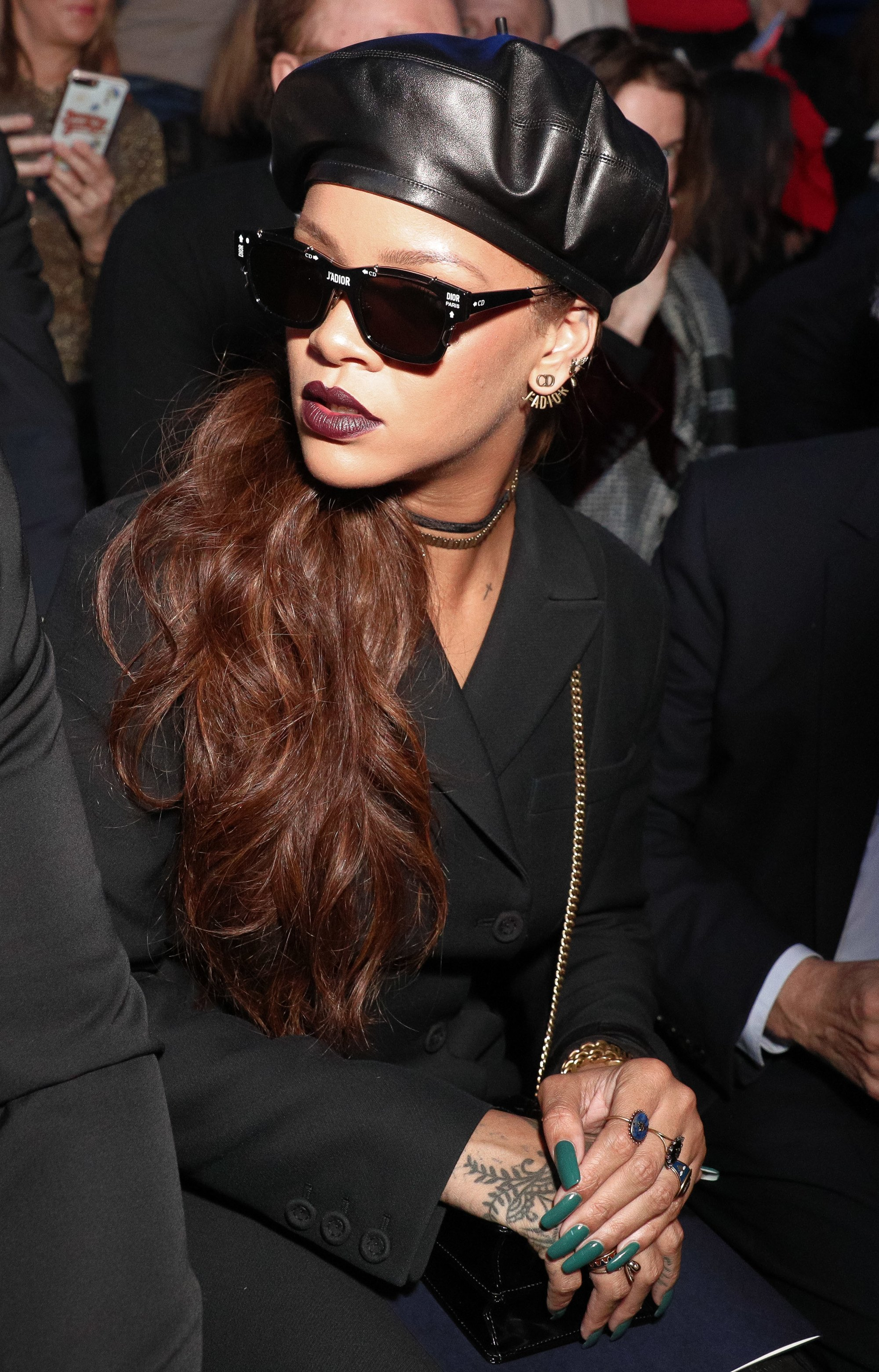 rihanna in the FROW st dior with a beret and side ponytail hairstyle