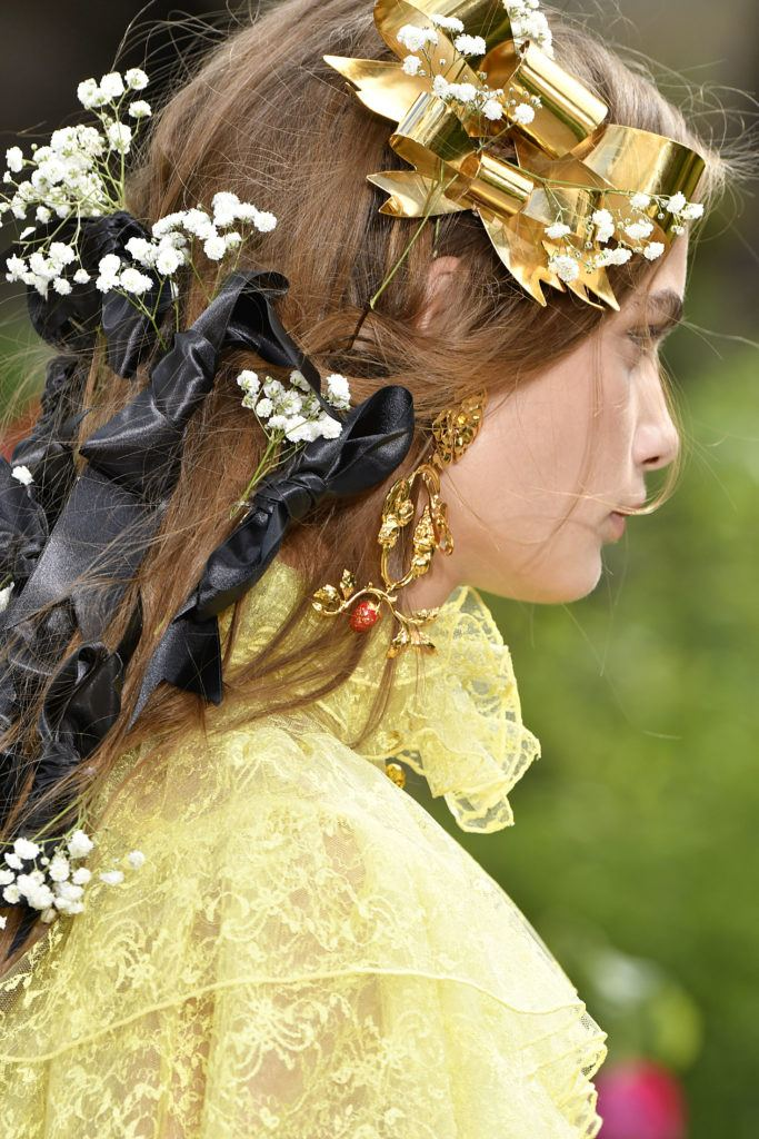 model with flowers and bows in her hair on the rodarte runway