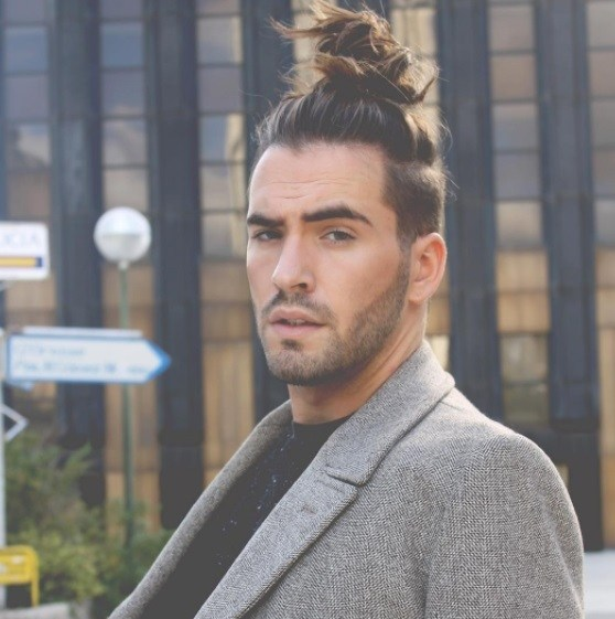 Top Knot Men: Male Model With Messy Top Knot Hairstyle Wearing Suit