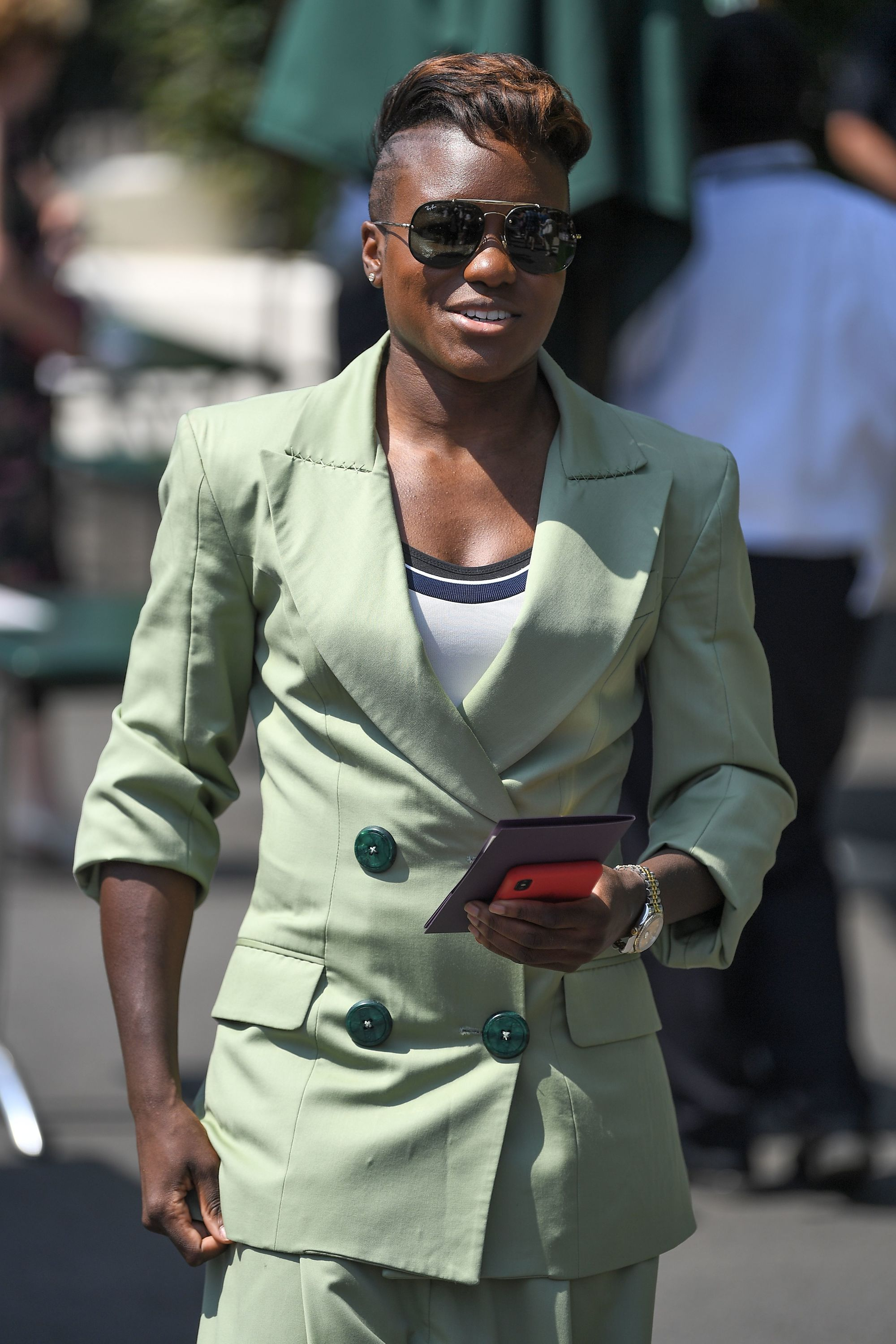 Nicola Adams at Wimbledon 2018 with golden brown short hair with shaved design undercut wearing mint green suit and sunglasses