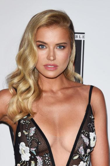 Sports Illustrated Fashionable 50 Party: tanya mityishina with glam side swept wavy curls wearing v cut dress
