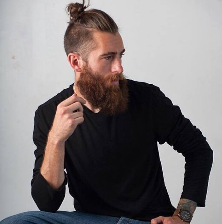 Top Knot Men: Shot Of Man With Top Knot Hairstyle With Beard