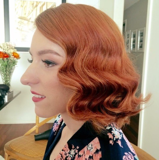 Redhead Woman With Her Bob Length Hair In Vintage Style Waves