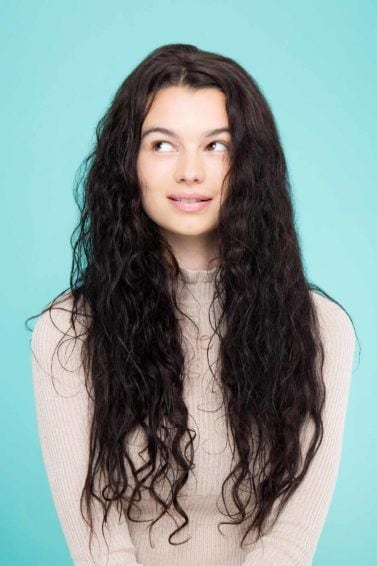 woman with wet long curly brunette hair