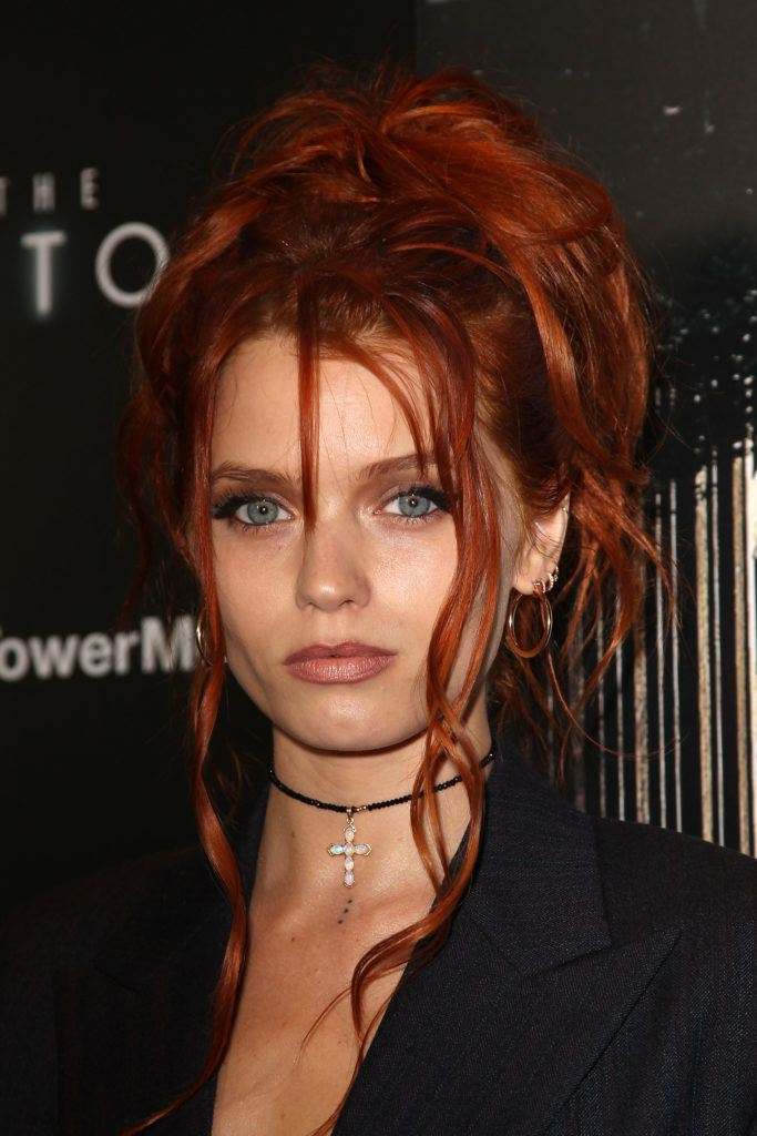 prom updos: abbey lee kershaw with red hair styled in a messy undone updo hairstyle