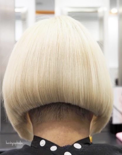 back view of a woman with an a line blonde bob with shaved detail