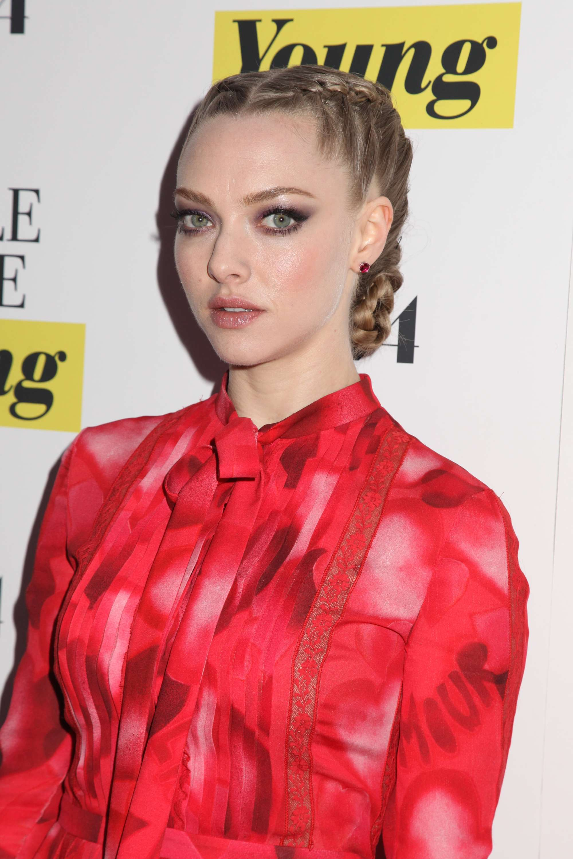 prom updos: amanda seyfried on the red carpet with double dutch braided bun updo wearing red dress