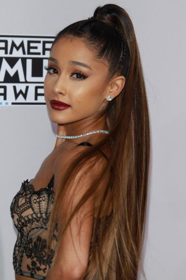singer ariana grande swishing her long high ponytail