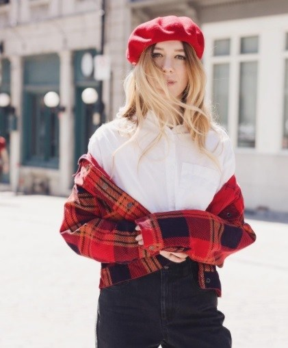 streetstyle shot of a blogger wearing a red beret