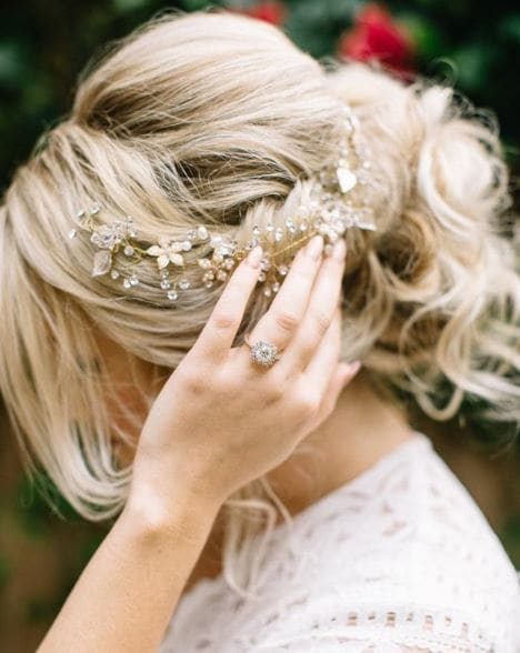 Blonde hair in elegant wedding updo with gold jewelled floral acessories