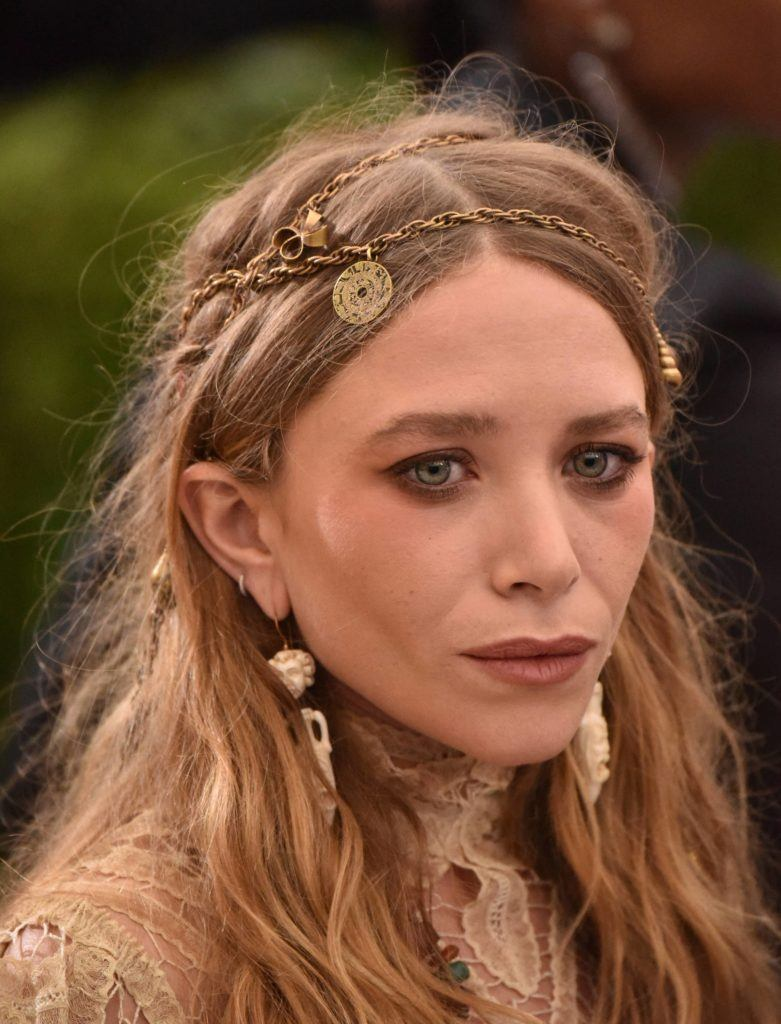 1970s hairstyles: Ashley Olsen with boho hair accessories
