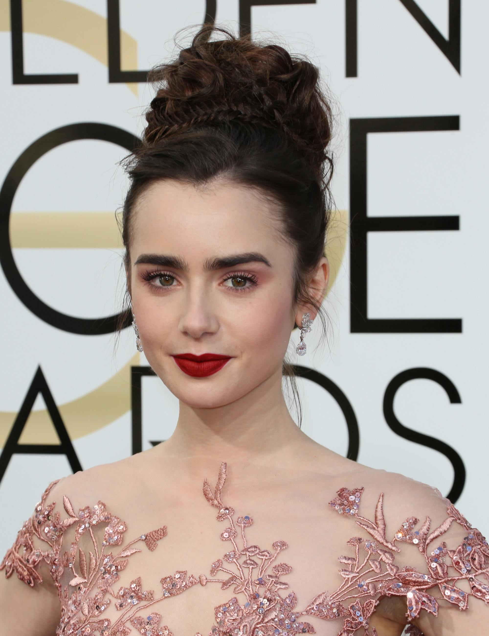 prom updos: lily collins with braided bun updo hairstyle at the golden globes