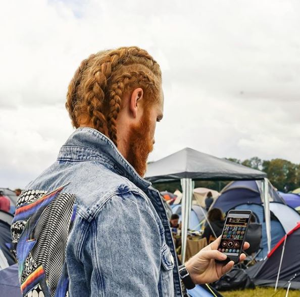 ginger haired male model with all over braided long hair in instagram festival post