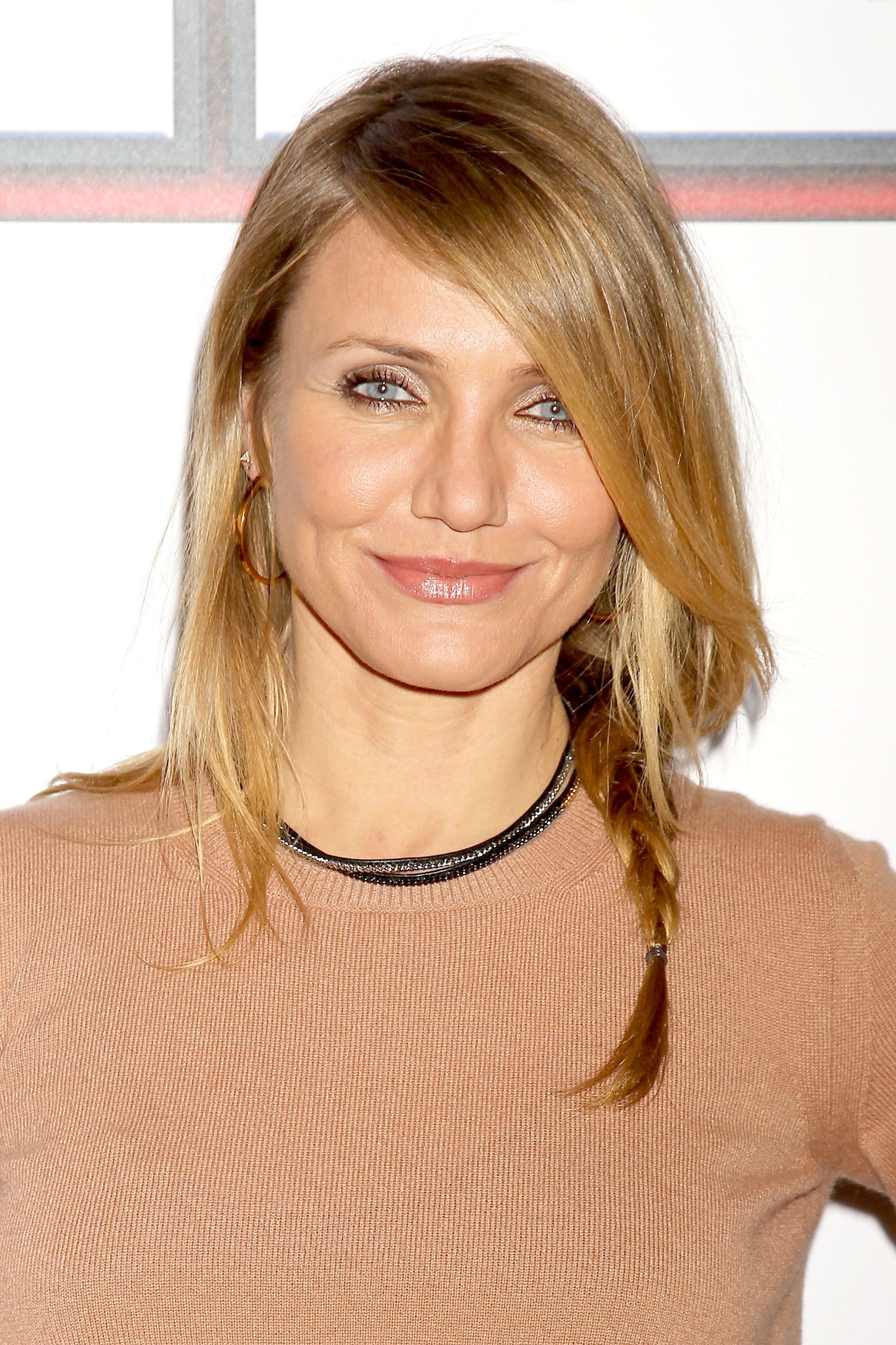 actress cameron diaz on the red carpet with her hair in a side braid with long side bangs