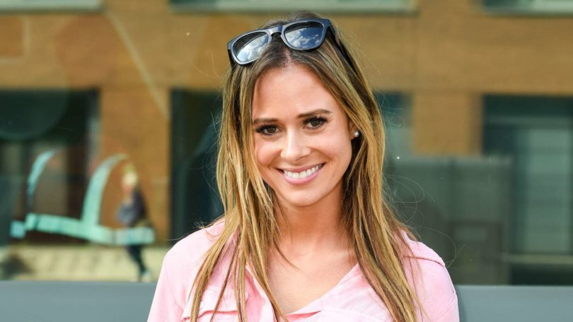 love island star camilla thurlow with blonde hair wearing a pink shirt