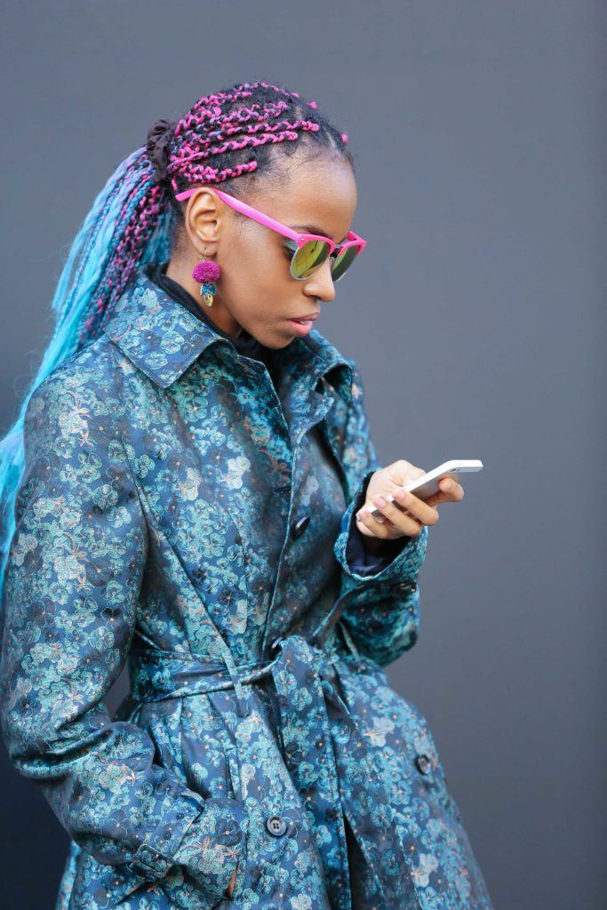 Long box braids hairstyles: Street style photo of a woman with coloured long box braids in a ponytail