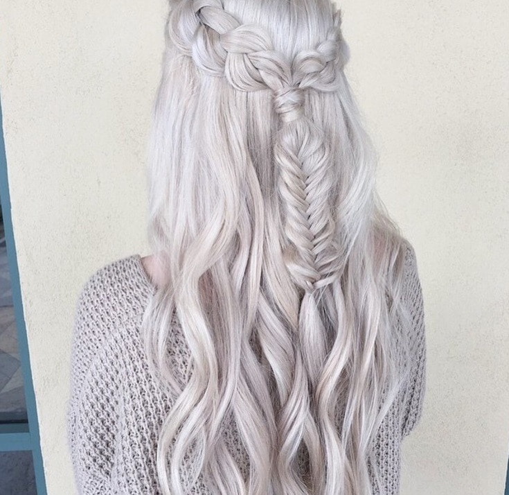 back shot of woman with pearl silver blonde hair that's been braided into a half up fishtail style