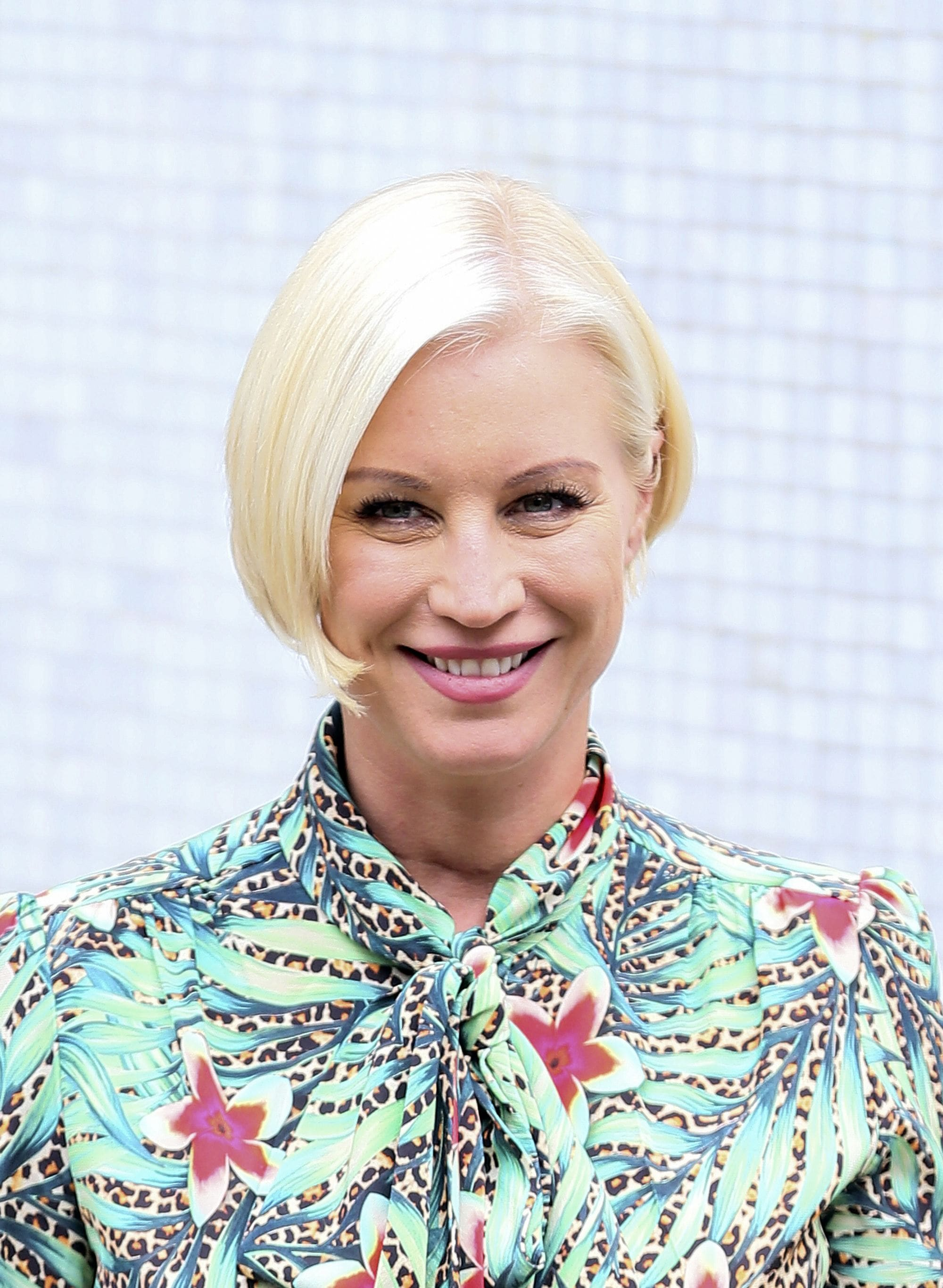 tv presenter denise van outen with a bright blonde long pixie cut