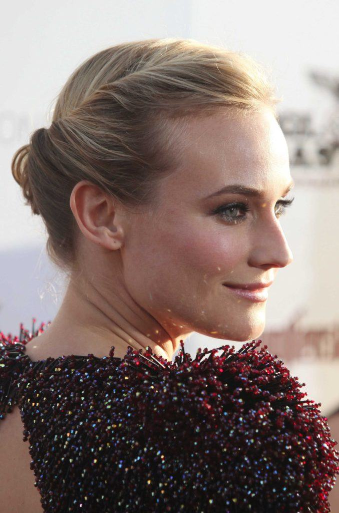 prom hairstyles for medium hair: diane kruger blonde straight hair styled in a twisted updo