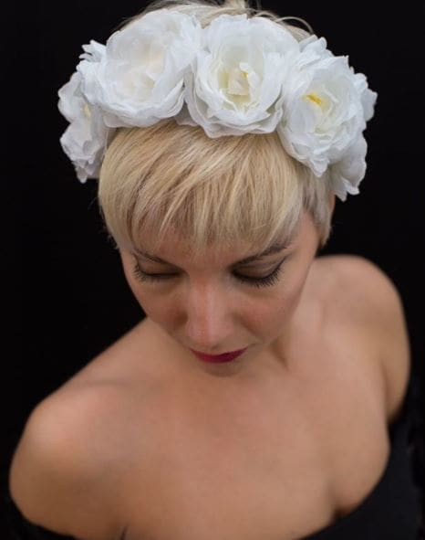 Light platinum blonde pixie cut with white floral headband