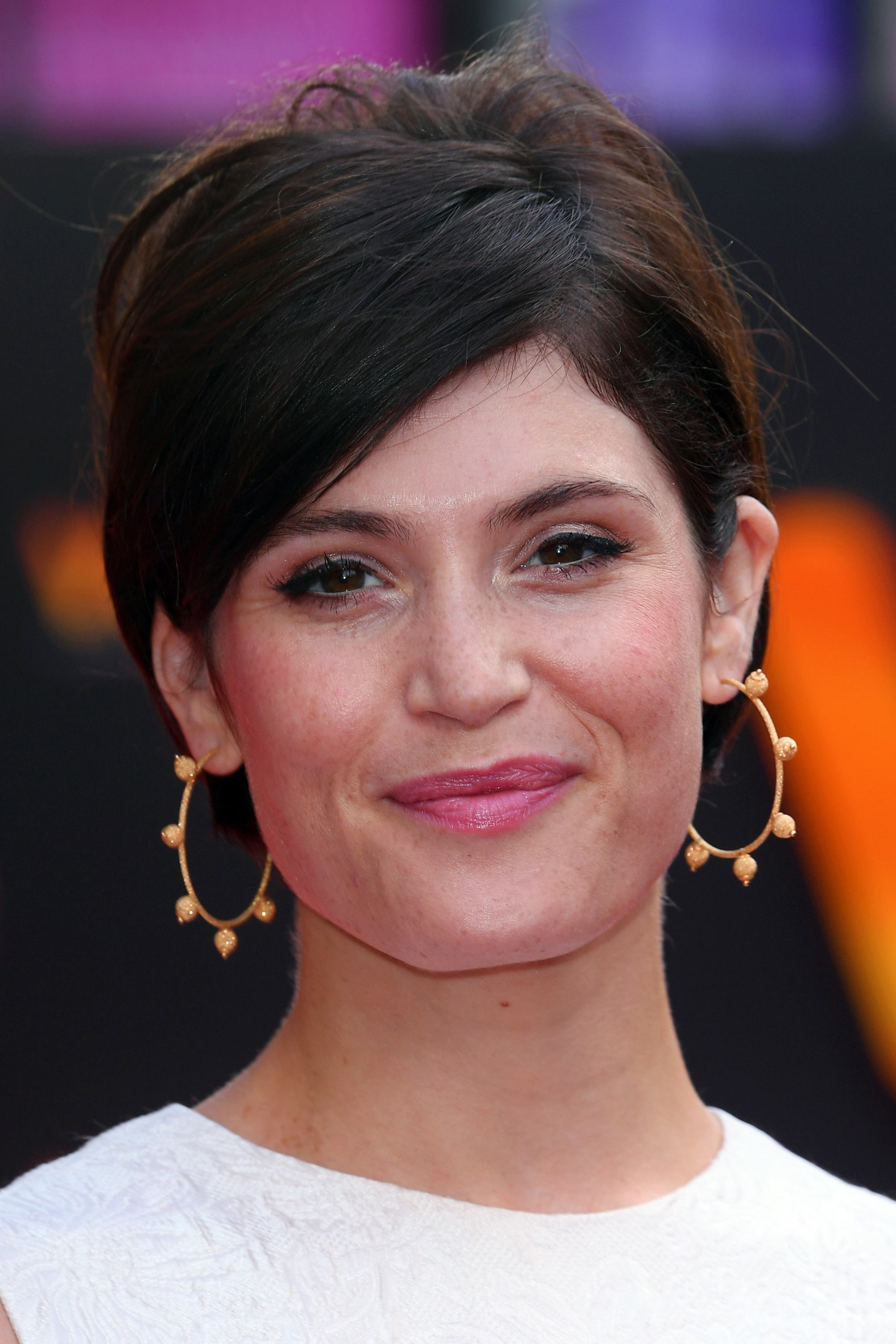 british actress gemma arterton with her dark brunette hair in an updo with side bangs