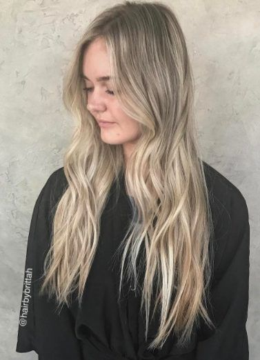 side profile of a woman with long golden blonde ombre hair