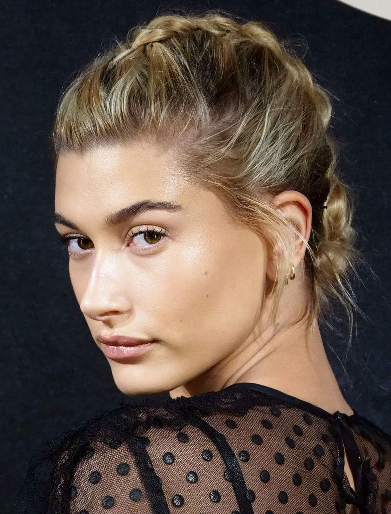 prom updos: model hailey baldwin with her dirty blonde hair in a french braided updo
