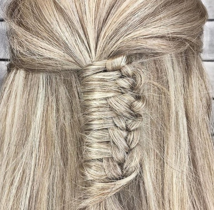 back shot of woman with half up stair case braid hairstyle