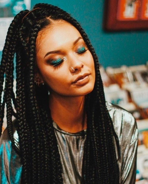 Long box braids hairstyles: Girl with long box braids tied in a half-up ponytail