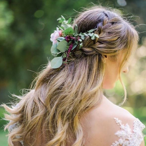 Blonde long wavy hair with double braids half-up. half-down hairstyle with floral detailing